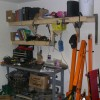 Yet another workbench and more shelves, miata engine/parts, and engine hoist